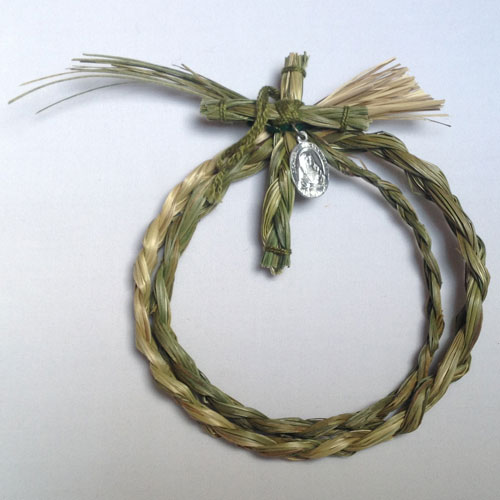 Sweetgrass circle with cross and St. Kateri medallion